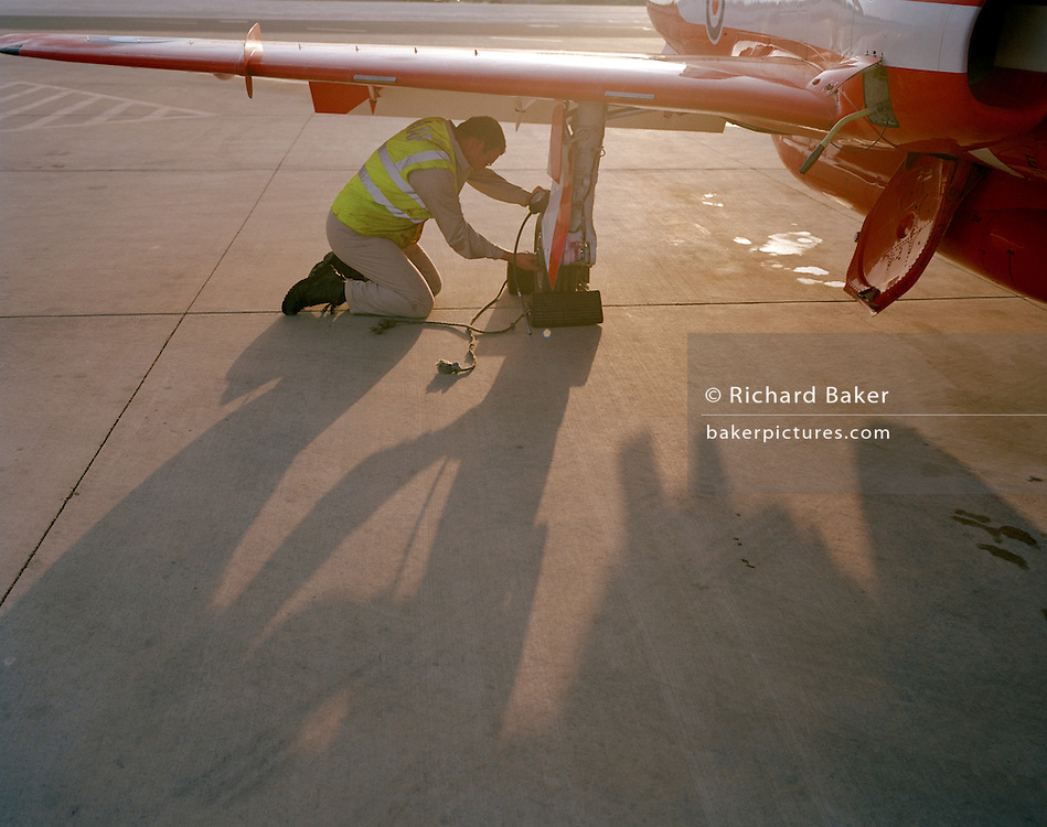 Ground crew prepare BAE Systems Hawk jet of the 'Red Arrows', Britain's Royal Air Force aerobatic team.