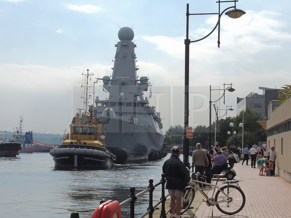 © Licensed to London News Pictures. 02/09/2014. Cardiff, UK. NATO warship HMS Duncan, , a type 45 destroyer with multi function radar capability (air defence) arrives at Roath Dock in Cardiff Bay ahead of the Summit this Thursday - it is one of several vessels which is expected in the historic docks. Photo credit : Ian Homer/LNP