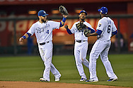 Oct 14, 2014; Kansas City, MO, USA; Kansas City Royals outfielders Jarrod Dyson (1) , Alex Gordon (4) and Lorenzo Cain (6) celebrate after defeating the Baltimore Orioles in game three of the 2014 ALCS playoff baseball game at Kauffman Stadium. Mandatory Credit: Peter G. Aiken-USA TODAY Sports