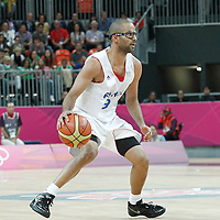 31 July 2012: Tony Parker of France dribbles during 71-64 Team France victory over Team Argentina, during the men's basketball preliminary, at the Basketball Arena, in London, Great Britain.