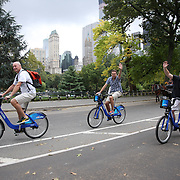 Citi Bike riders in Central Park, Manhattan, New York. Citi Bike the NYC Bicycle Share Program sponsored by Citi Bank, launched in late May 2013 giving access to thousands of bikes at docking stations throughout  Manhattan and parts of Brooklyn. Manhattan, New York, USA. 30th September 2014. Photo Tim Clayton