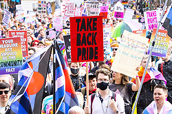 """© Licensed to London News Pictures . 28/08/2021. Manchester, UK. A """" Take Back Pride """" banner is carried along the march . People take part in a Reclaim Pride march through Manchester City Centre , in opposition to the management of the city's """"official"""" Manchester Pride charity festival . The Manchester Pride charity parade was cancelled in 2020 due to Coronavirus . An """"equality march"""" organised by Manchester Pride charity was due to take place on Deansgate as the protest passed through the Gay Village . Protesters object to Manchester Pride charity's withdrawal of funding for the LGBT Foundation's condom distribution scheme and HIV charity George House Trust as well as increasing commercialisation of the annual event . Photo credit: Joel Goodman/LNP"""