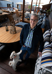 Steve Keihner, whose chain of Terra Outdoor stores was voted Best Patio Furniture retailer in the Bay Area News Group's Best in the East Bay poll, poses for a photograph with his dog Rascal at the Berkeley, Calif. outlet, Tuesday, March 16, 2021. (Photo by D. Ross Cameron)