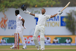 July 26, 2017 - Galle, Sri Lanka - Indian cricketer Shikhar Dhawan celebrates after scoring 100 runs during the 1st Day's play in the 1st Test match between Sri Lanka and India at the Galle International cricket stadium, Galle, Sri Lanka on Wednesday 26 July 2017. (Credit Image: © Tharaka Basnayaka/NurPhoto via ZUMA Press)
