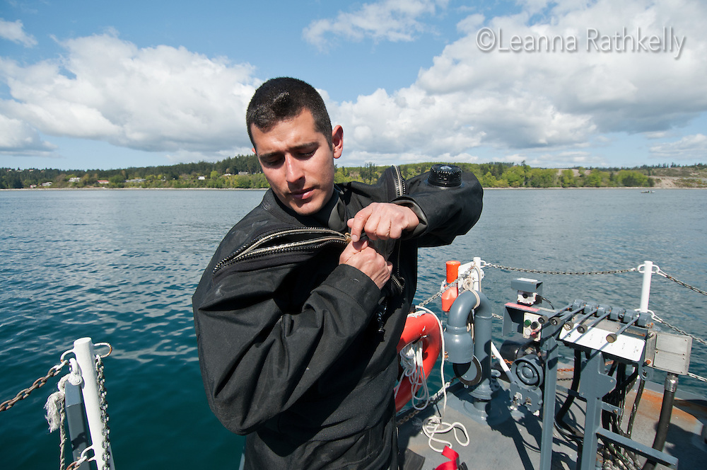 Navy divers learn to use the rebreather aparatus in a course to become clearance divers off the coast of Victoria, BC
