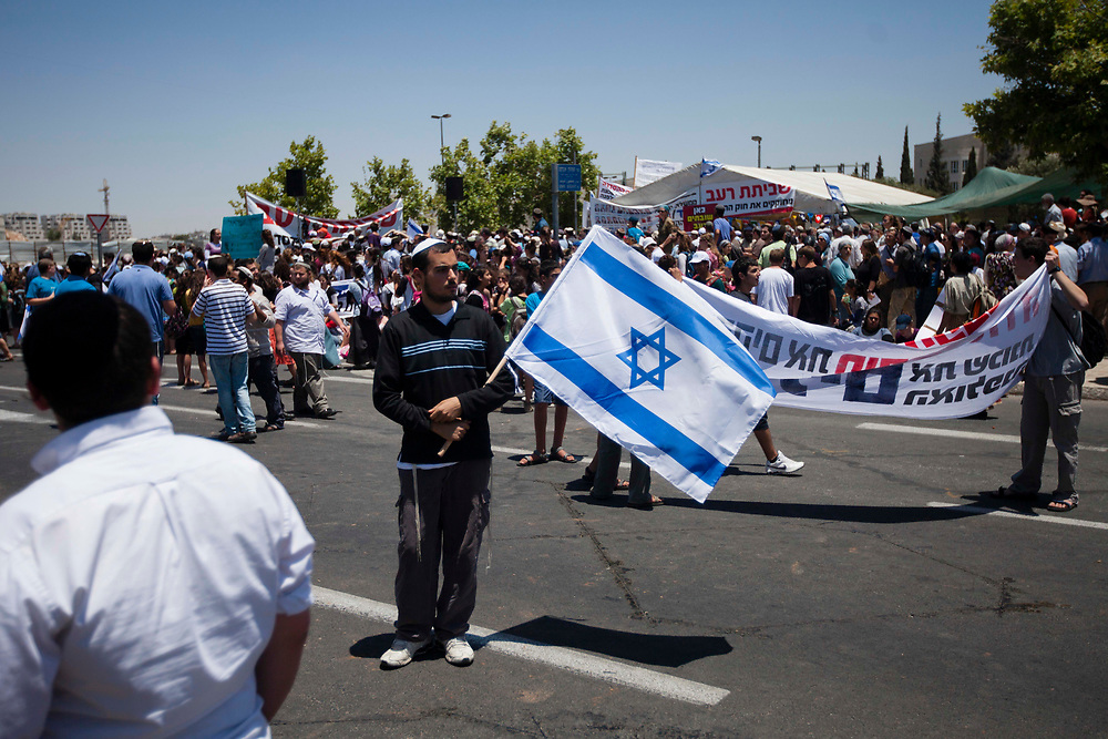 Israeli settlers take part in a protest calling on Israel's government to approve a proposed bill in parliament that aims to retroactively legalize West Bank outposts that have been built on private Palestinian land, outside the Supreme Court in Jerusalem, on June 6, 2012. Israel's parliament rejected the proposed bill by right-wing legislators, meant to prevent the Israeli government decision to evacuate and relocate five houses at the Ulpana neighborhood in the West Bank settlement of Beit El, after the Israeli Supreme Court ruled that the houses were illegaly built on land classified as private Palestinian property, and must be evacuated and demolished by July 1.