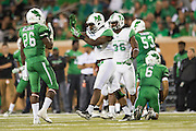 Marshall Thundering Herd linebacker Frankie Hernandez (35) celebrates after a sack against the North Texas Mean Green during the 2nd half at Apogee Stadium in Denton, Texas on October 8, 2016. (Cooper Neill for The Herald-Dispatch)