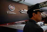 A guard stands near a Cadillac display at the Auto Shanghai 2009 in Shanghai, China, on Monday, April 20, 2009. Automakers from across the world are increasingly focusing their efforts on China, the largest auto market in the world and the only major market with prospects of high growth rate.