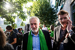 © Licensed to London News Pictures. 14/06/2018. London, UK. Jeremy Corbyn joins the silent procession at Grenfell Tower to mark the first anniversary of the Grenfell Tower Fire in which 72 people were killed. Grenfell Tower caught fire on the night of June 14, 2017 after a small blaze started in one of the flats which spread rapidly up the outside of the 24-floor tower block. A public inquiry is currently underway. Photo credit: Rob Pinney/LNP