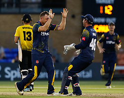 Glamorgan's Graham Wagg celebrates taking the wicket of Gloucestershire's Benny Howell with team-mate Chris Cooke<br /> <br /> Photographer Simon King/Replay Images<br /> <br /> Vitality Blast T20 - Round 8 - Glamorgan v Gloucestershire - Friday 3rd August 2018 - Sophia Gardens - Cardiff<br /> <br /> World Copyright © Replay Images . All rights reserved. info@replayimages.co.uk - http://replayimages.co.uk