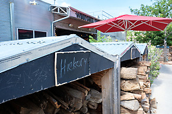 Hickory wood pile at the Woodshed Smokehouse, Trinity Trails along Trinity River, Fort Worth, Texas, USA.