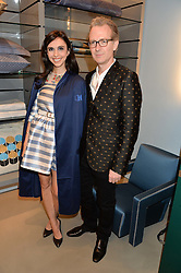 ASHLEY HICKS and his wife KATA DE SOLLIS at the launch of the new Frette store at 43 South Audley Street, London on 6th October 2016.