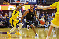 Feb 18, 2019; Morgantown, WV, USA; Kansas State Wildcats guard Barry Brown Jr. (5) dribbles during the first half against the West Virginia Mountaineers at WVU Coliseum. Mandatory Credit: Ben Queen-USA TODAY Sports