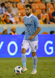 August 4, 2018 - Houston, TX, U.S. - HOUSTON, TX - AUGUST 04:  Sporting Kansas City midfielder Graham Zusi (8) dribbles the ball during the soccer match between Sporting Kansas City and Houston Dynamo on August 4, 2018 at BBVA Compass Stadium in Houston, Texas.  (Photo by Leslie Plaza Johnson/Icon Sportswire) (Credit Image: © Leslie Plaza Johnson/Icon SMI via ZUMA Press)
