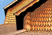 """Wood roof and siding detail. Heddal stave church is Norway's largest stave church. This triple nave stave church, which some call """"a Gothic cathedral in wood,"""" was built in the early 13th century and restored in 1849-1851 and the 1950s. Heddal stavkirke is in Notodden municipality, Telemark County, Norway."""