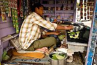 A Paanwala making Paan at a roadside stall in Varanasi, Uttar Pradesh, India