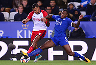 Solomon Rondon of West Bromwich Albion (l) battles with Wes Morgan of Leicester city .Premier league match, Leicester City v West Bromwich Albion at the King Power Stadium in Leicester, Leicestershire on Monday 16th October 2017.<br /> pic by Bradley Collyer, Andrew Orchard sports photography.