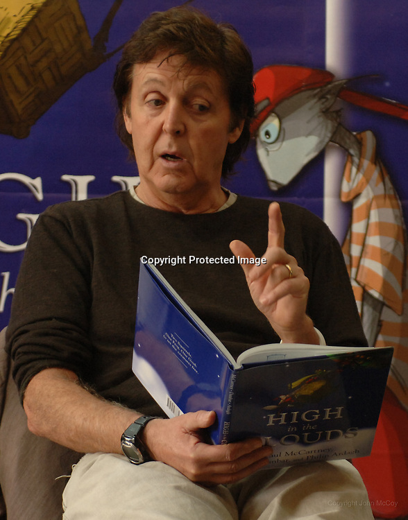 """11.8.05--Los Angeles CA--  Paul McCartney reads a chapter from his  childrens book """"High in the Clouds"""" to some children at the Borders book store in Westwood.  Kids from Fairburn Elementtary School were lucky enough to meet the author, and ask him questions about his book while a block long line of fans waited outside to have the former Beatle sign copies of the book. Photo by John McCoy/Staff Photographer Los Angeles Daily News"""