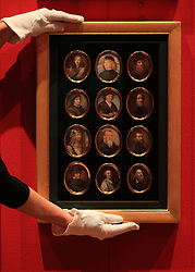 An employee of the Royal Collection Trust adjusts part of Giuseppe Macpherson's 224 Miniatures, which are on display in the Portrait of the Artist exhibition at the Queen's Gallery, Buckingham Palace, London.