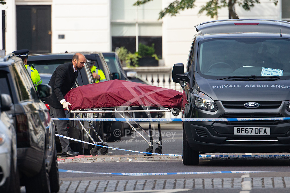 Coroners remove a body from a forensics tent in Cathcart Road, Chelsea, following the fatal stabbing on the night of May 30th 2018 of a man in his forties, said to be a delivery driver who refused to hand over his cash to robbers. London, May 31 2018.