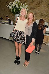 Left to right, the HON.SOPHIA HESKETH and MARY GREENWELL at a summer drinks party hosted by Bec Astley Clarke at the Serpentine Sackler Gallery, Hyde Park, London on 17th June 2014.