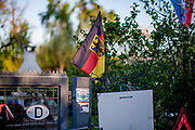 A German national flag flies in a garden colony.