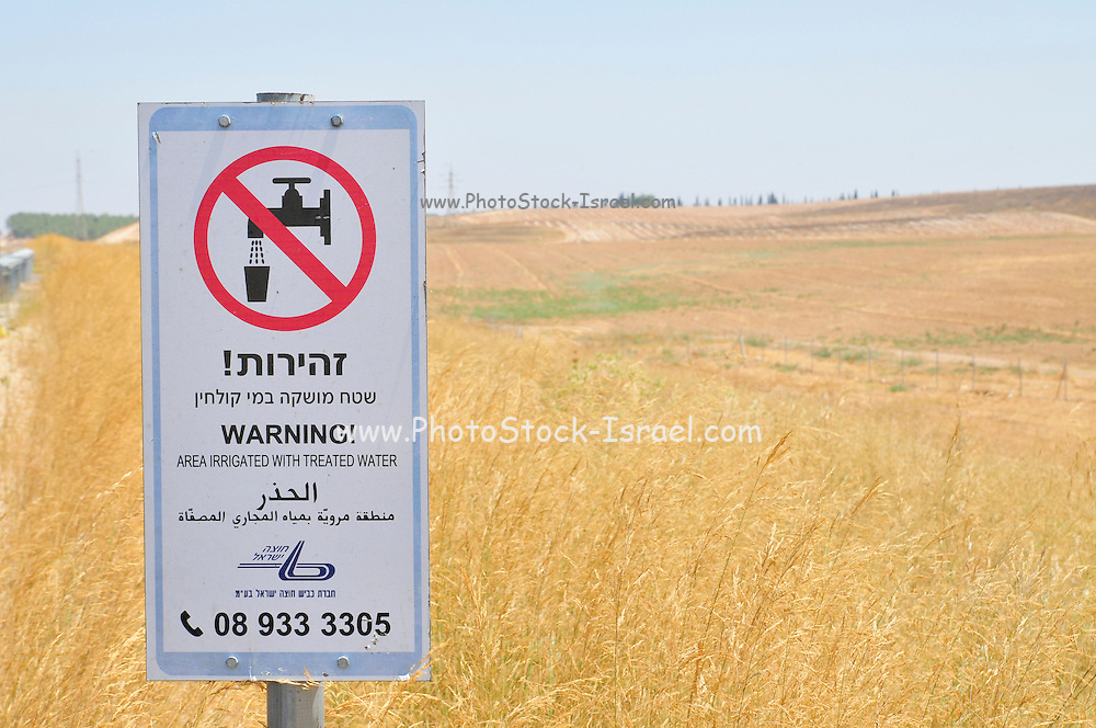 Israel, Highway 6, A warning sign in Hebrew, English and Arabic, reading: Area irrigated with treated water, 20 July 2009