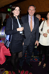 LADY LAURA CATHCART and WILLIAM CASH at Tatler Magazine's Little Black Book Party held at Annabel's, Berkeley Square, London on 5th November 2013.