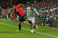 Greg Taylor (#3) of Celtic is brought down by Romain Del Castillo (22) of Rennes during the Europa League match between Celtic and Rennes at Celtic Park, Glasgow, Scotland on 28 November 2019.