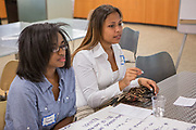 Purchase, NY – 31 October 2014. Gorton High School team members Imani Pierre, left, and Brooke Martinez discuss their case study. The Business Skills Olympics was founded by the African American Men of Westchester, is sponsored and facilitated by Morgan Stanley, and is open to high school teams in Westchester County.