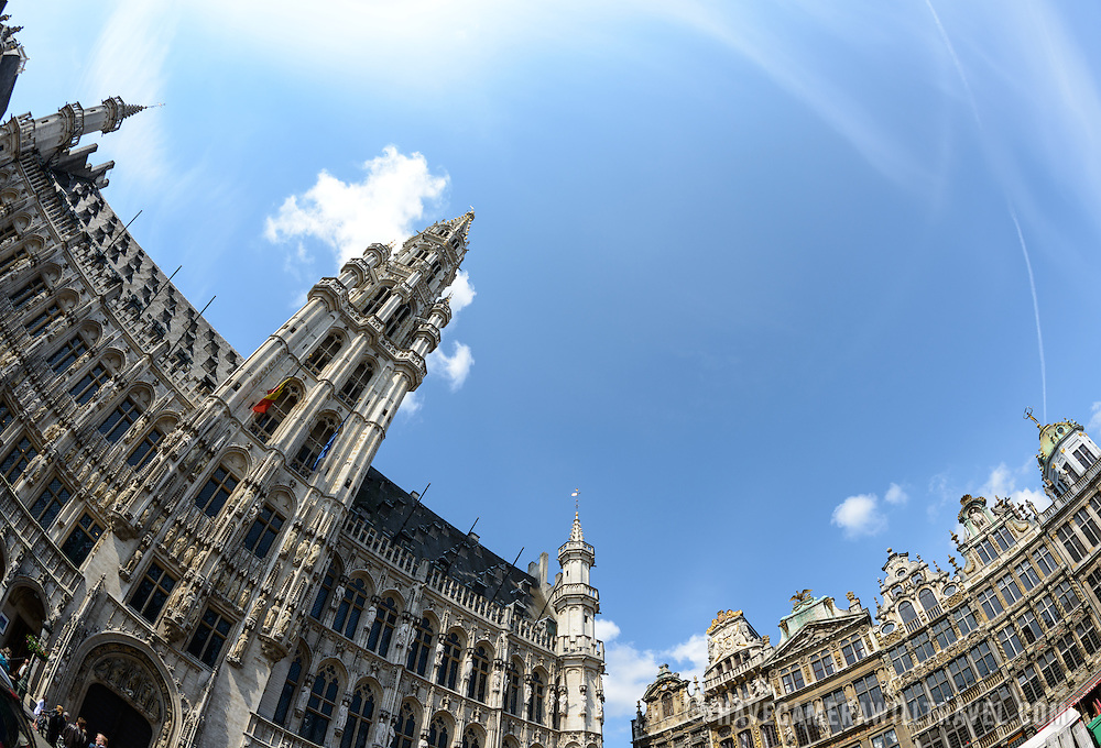 Fisheye shot of the buildings of the Grand Place, Brussels. At left is the main tower of the Town Hall (Hotel de Ville). Originally the city's central market place, the Grand-Place is now a UNESCO World Heritage site. Ornate buildings line the square, including guildhalls, the Brussels Town Hall, and the Breadhouse, and seven cobbelstone streets feed into it.