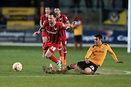 Chris Maguire of Oxford Utd is fouled by Tommy O'Sulivan of Newport ®.  Skybet football league two match, Newport county v Oxford Utd at Rodney Parade in Newport, South Wales on Tuesday 19th April 2016.<br /> pic by Andrew Orchard, Andrew Orchard sports photography.