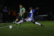Barry Fuller (Captain) of AFC Wimbledon, Jermaine Easter of Bristol Rovers FC battle during the Sky Bet League 2 match between Bristol Rovers and AFC Wimbledon at the Memorial Stadium, Bristol, England on 8 March 2016. Photo by Stuart Butcher.
