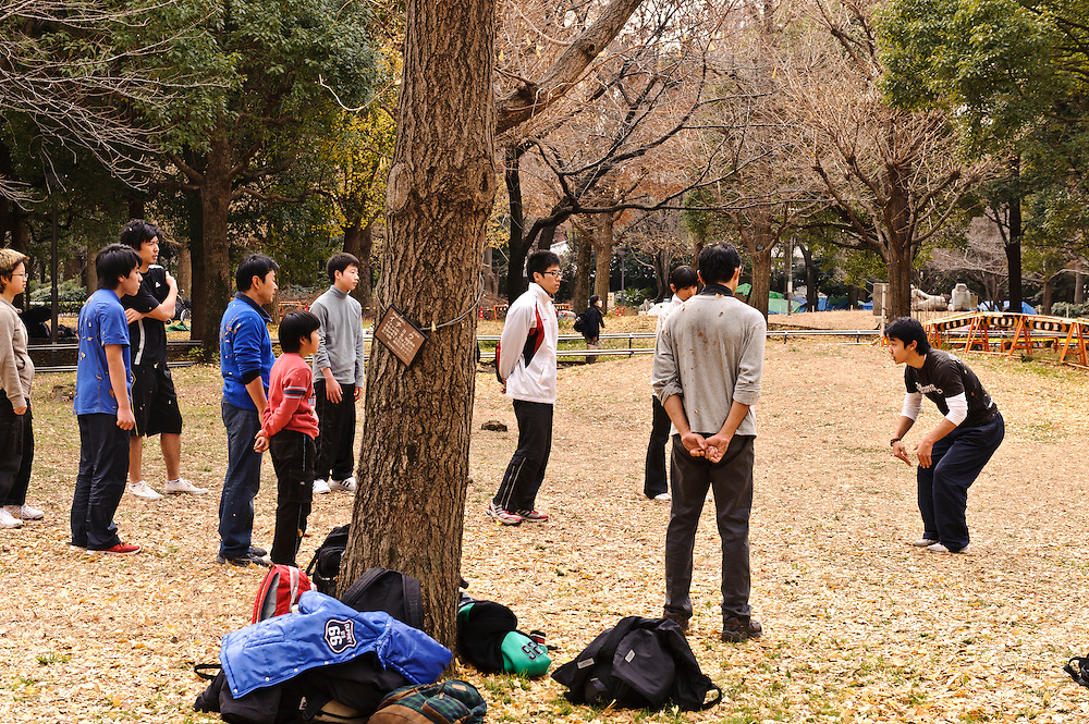 """Parkour coach Jun """"Sullivan Sato"""" with students. Parkour Tokyo group practice, Shinjuku Chuo Koen, Tokyo, Japan, January 15, 2012. Parkour is a modern method of physical training, also known as freerunning. It was founded in France in the 1990s. There is a small group of around 50 parkour practitioners in Tokyo."""