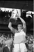 All Ireland Hurling Finals.1986..07.09.1986..09.07.1986..7th September 1986..September,every year,is the highlight of the GAA calendar with The All Ireland Finals being held in both codes. The senior and minor finals in each code are both played for on the same day. Each finalist has battled through provinical and knock out stages to reach the final.It is widely regarded as the pinnacle of a players career to reach and win an All Ireland Championship..In this years hurling finals,Cork played Offaly in the minor championship and a much fancied Galway team took on Cork in the senior final. Both matches were well fought and close encounters...In the minor final Offaly ran out winners against Cork with a score of 3.12 (21) to 3.9 (18)...Image shows the victorious Offaly captain,Michael Hogan,holding the Irish Press Cup aloft in celebration after winning the All Ireland Minor Hurling Final.