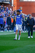 Connor Goldson of Rangers FC with his baby on his shoulders following the Ladbrokes Scottish Premiership match between Rangers and Celtic at Ibrox, Glasgow, Scotland on 12 May 2019.
