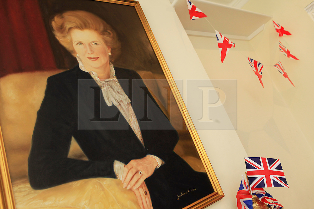 © Licensed to London News Pictures 10/04/2013.A portrait of the late Margaret Thatcher hangs on the wall above the condolence book, set up at Finchley Conservatives Association in north London..London, UK.Photo credit: Anna Branthwaite