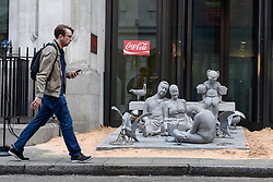 "© Licensed to London News Pictures. 10/04/2017. London, UK.  A sculpture by artist James de Caires Taylor, depicting a family on a beach, is installed by Greenpeace in front of the entrance of Coca-Cola's London headquarters on Wimpole Street as part of the campaign called ""Don't let Coke choke our oceans"".  The campaign highlights the negative environmental impact of plastics in the oceans as well as Coca-Cola's increased use of throwaway plastics as opposed to recycled plastics.   Photo credit : Stephen Chung/LNP"