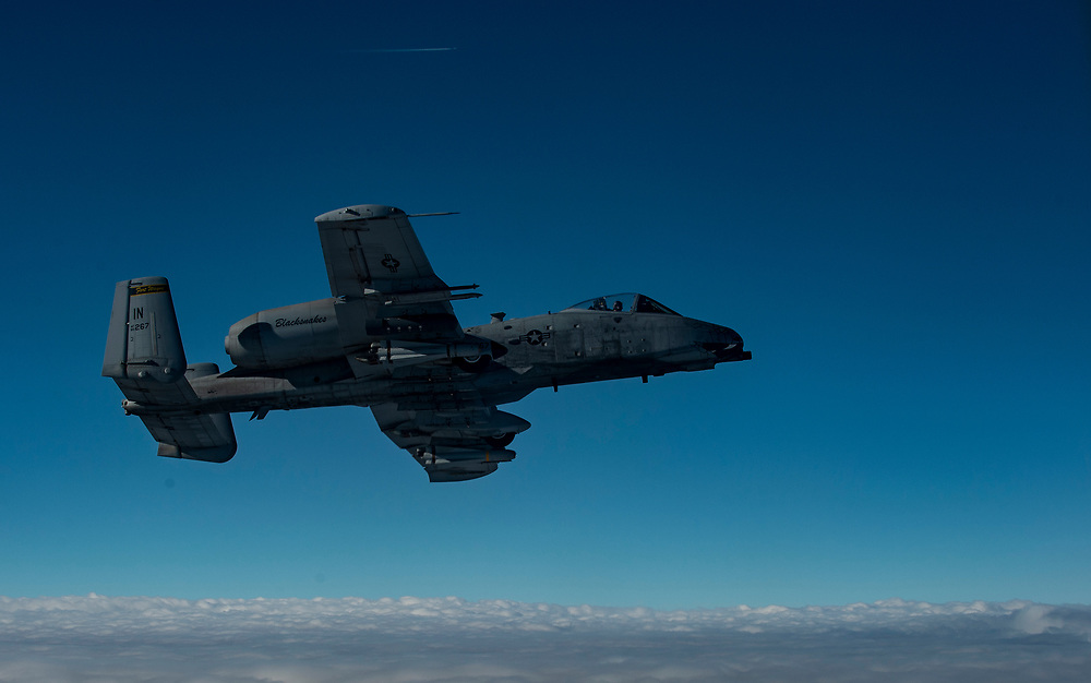 U.S. Air Force A-10 Warthog flies off the wing of a USAF KC-135 Stratotanker before refueling, to continue providing combat air support for Operation Inherent Resolve, Jan 30, 2015, in Iraq. The U.S. led coalition has been conducting air strikes against the Da'esh since August 2014. (U.S. Air Force Photo by Staff Sgt. Perry Aston/Not Reviewed)