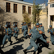 Afghan National Police (ANP) cadets react to a simulated attack by the Taliban during combat exercises at the ANP Academy in Kabul, Afghanistan.