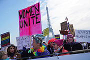 January, 21st, 2017 - Paris, Ile-de-France, France: Women protesters with 'Women Unite' placard at Trocadero with Eiffel Tower behindThousands of protesters in Paris join anti-Trump Women's March around the world.