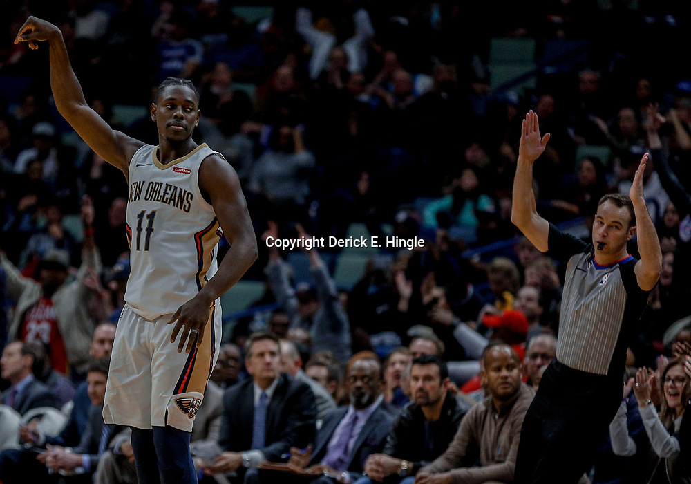 Dec 10, 2017; New Orleans, LA, USA; New Orleans Pelicans guard Jrue Holiday (11) celebrates a three point basket against the Philadelphia 76ers during the fourth quarter at the Smoothie King Center. The Pelicans defeated the 76ers 131-124. Mandatory Credit: Derick E. Hingle-USA TODAY Sports