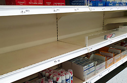 "© Licensed to London News Pictures. 24/09/2020. London, UK. A box of Colgate toothpaste on an empty shelf of in Wilko supermarket in London, as essential items start to run out, amid a possible second lockdown due to a rise in COVID-19 cases. Foreign Secretary, DOMINIC RAAB has said that, a second national lockdown could be needed if the latest coronavirus restrictions do not work but the government will ""take every effort to avoid that"". Photo credit: Dinendra Haria/LNP"
