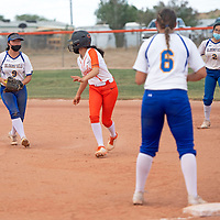Bloomfield centerfielder Dione Archibeque (9) runs Gallup Bengal Brenna Becenti (1) back to first base Friday afternoon at Gallup High School in Gallup.