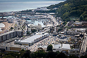 An overview of the Western docks of Dover. Haulage lorries line up along the A20 after arriving into the Eastern Dock of the Port of Dover where the cross channel port is situated with ferries departing to go to Calais in France, on 26th August 2020 in Dover, Kent, United Kingdom.  Dover is the nearest port to France with just 34 kilometres 21 miles between them. It is one of the busiest ports in the world. As well as freight container ships it is also the main port for P&O and DFDS Seaways ferries.