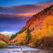 Brennen Fitzgerald fishes in the Eagle River near Wolcott Colorado at sunset.
