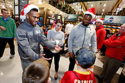 Corporate Event and Promotional Marketing Photographer in Kansas City - Kansas City Chiefs players, Charcandrick West and Dontari Poe accompany members of a Football Club as they shop for items on their wish list at the Sports Matter Holiday Shopping event hosted by DICK'S Sporting Goods  in Leawood, Kansas. Photo by Colin E. Braley for Dick's Sporting Goods