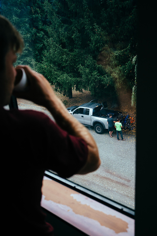 Yuri Choufour looks out at mountain bikers assembling their bikes for a day of riding in Leavenworth, Washington.