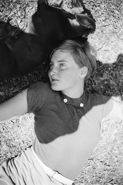 Woman and dog lying on the grass (Gertraud Braun), Austria, 1934