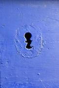 Keyhole in blue door